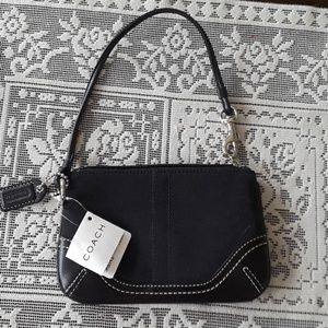 Brand new coach wristlet with tags.
